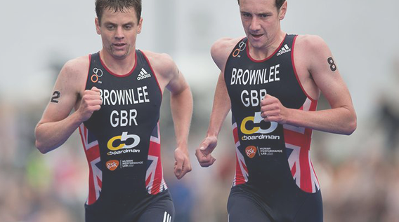 Athlete Brownlee runners taking part in a triathlon