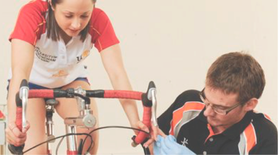 Athlete Cyclist monitoring training performance with sports scientist