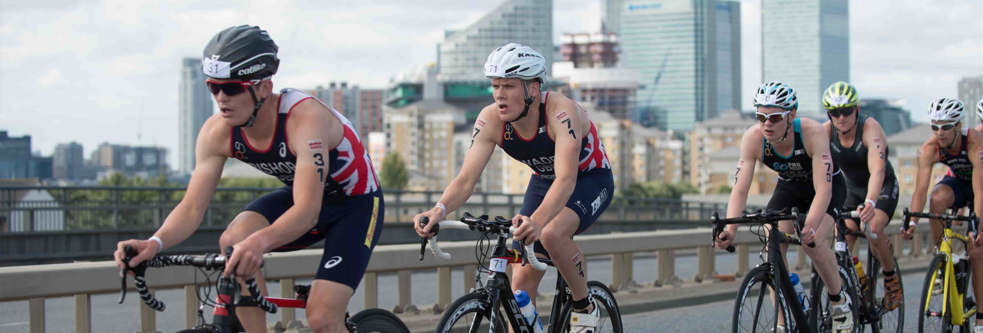 Group of athlete cyclists taking part in a triathlon race