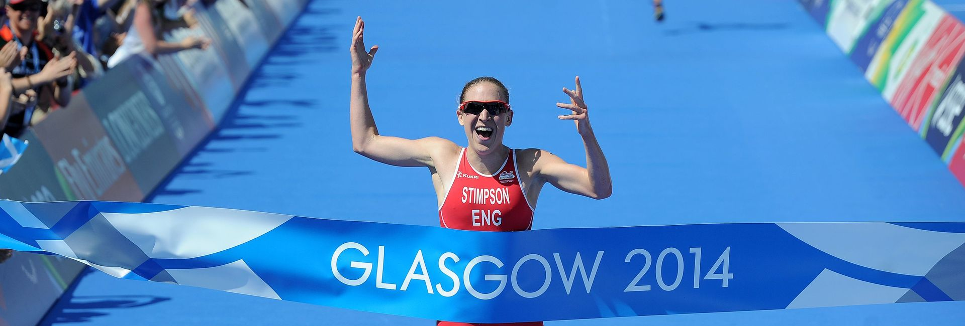 Athlete runner finishing the Glasgow 2014 triathlon in first place