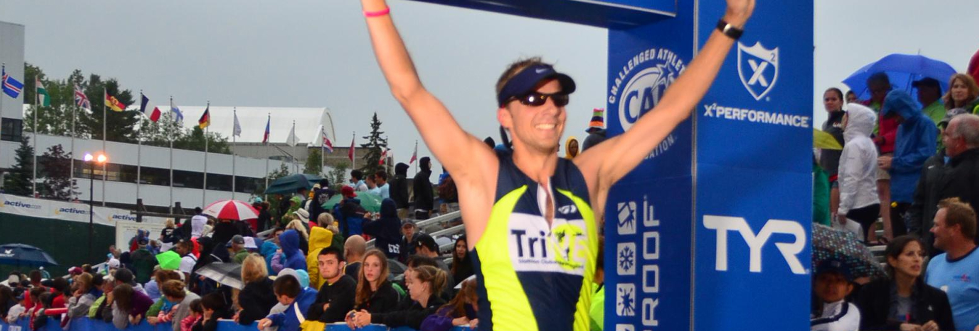 Athlete runner celebrating after completing triathlon race