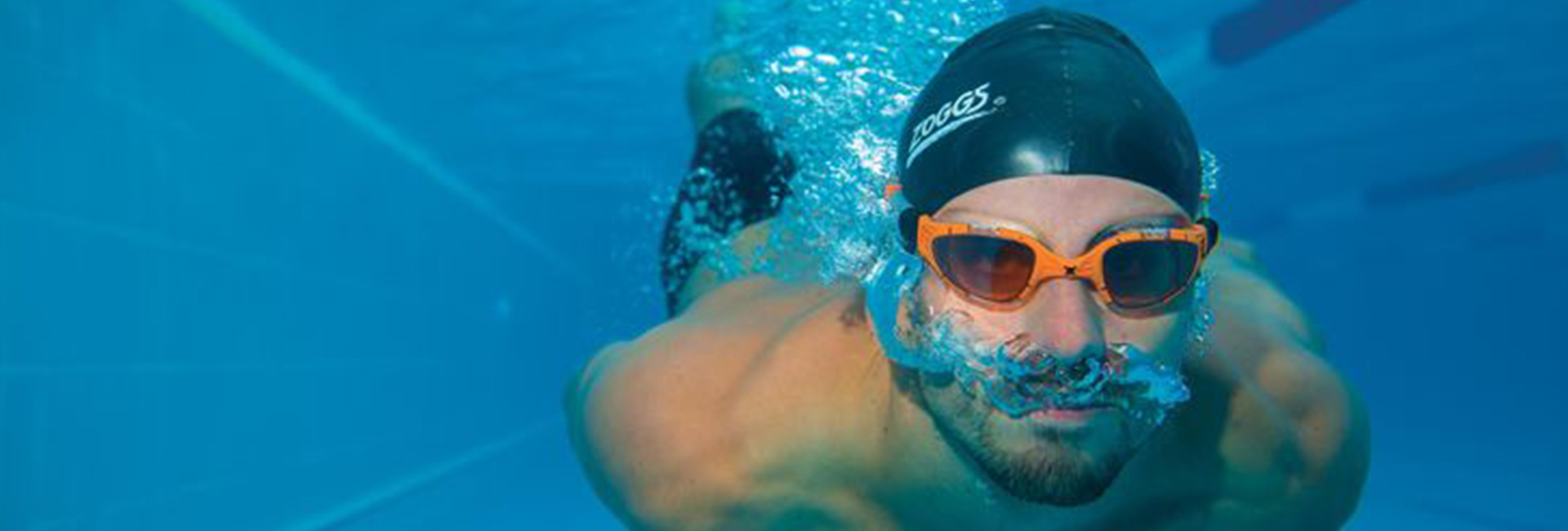 Athlete swimming underwater in the pool
