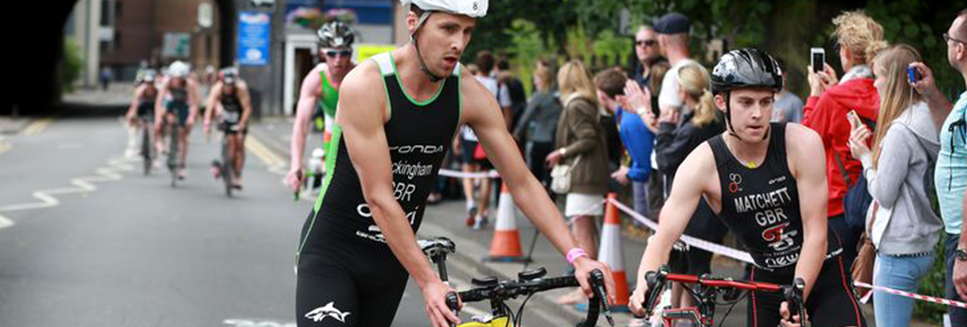 Two Cyclists taking part in a triathlon race