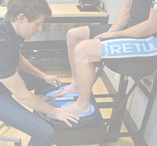 Athlete runner foot examination by sport scientist