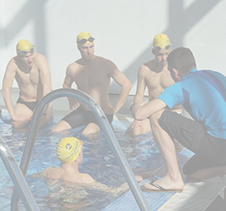 Swimming Coach Discussing performance with athlete swimmers in pool