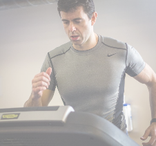Athlete runner monitoring performance on a treadmill
