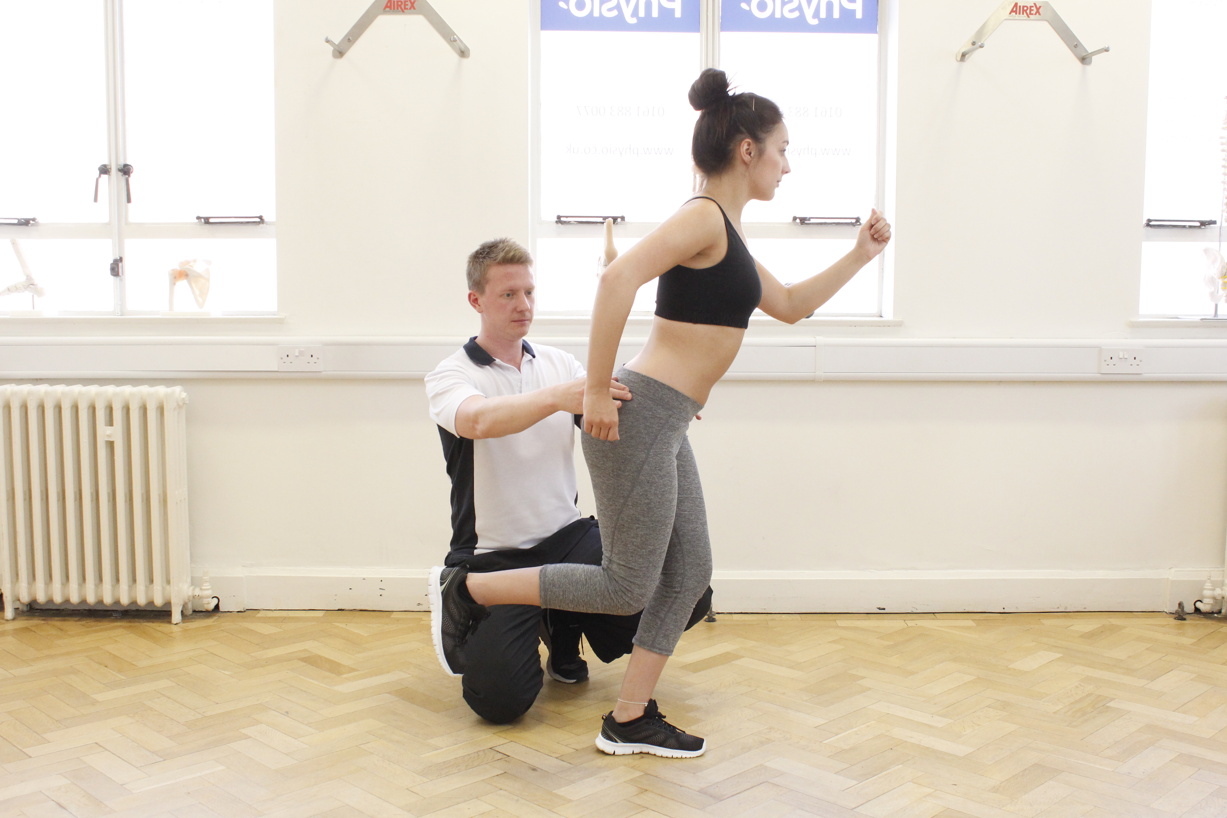 Physiotherapist guiding athlete with posture