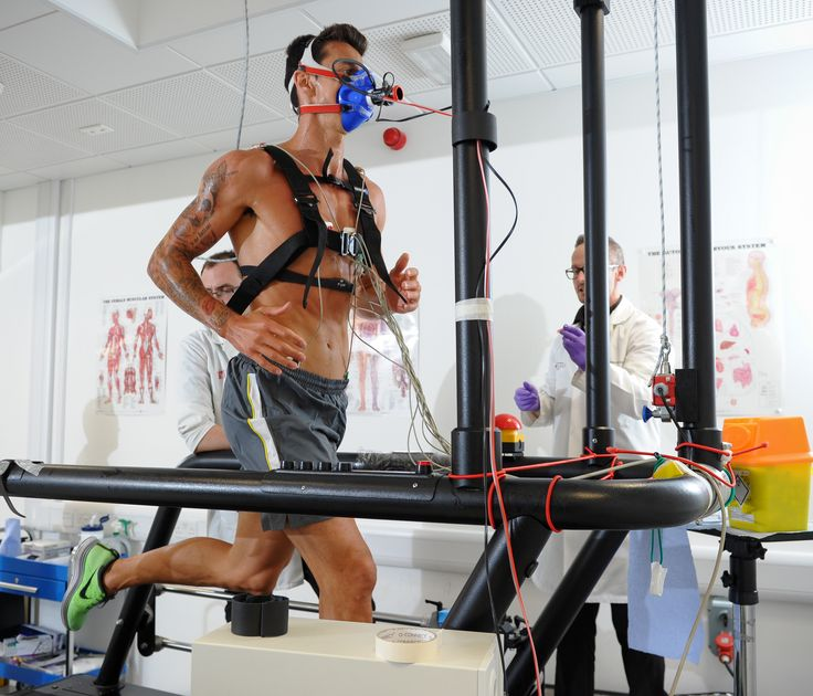 Sports Scientist Monitoring Performance on athlete runner