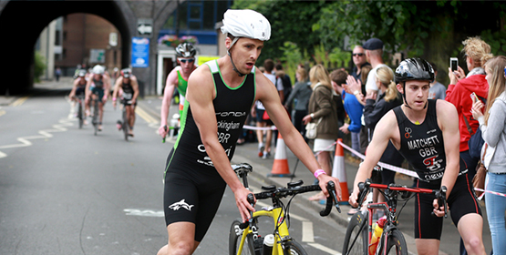 Pair of athlete cyclists taking part in a triathlon race