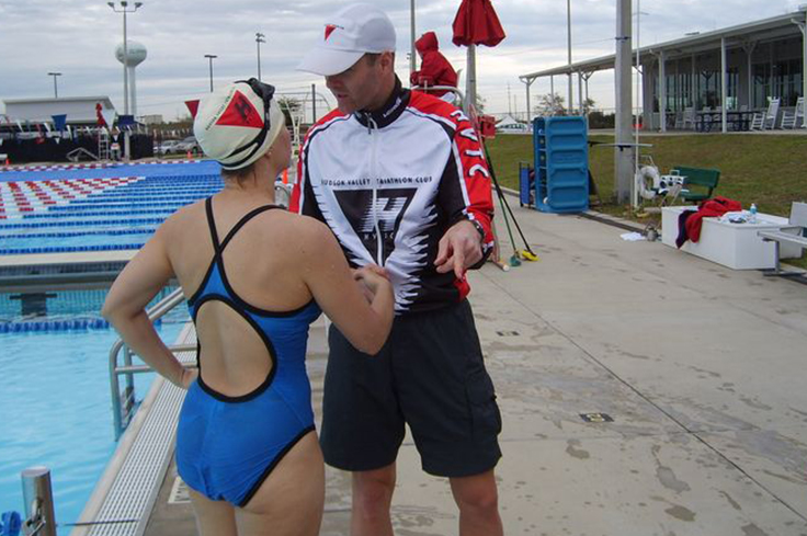 Swimming Coach discussing performance with athlete swimmer