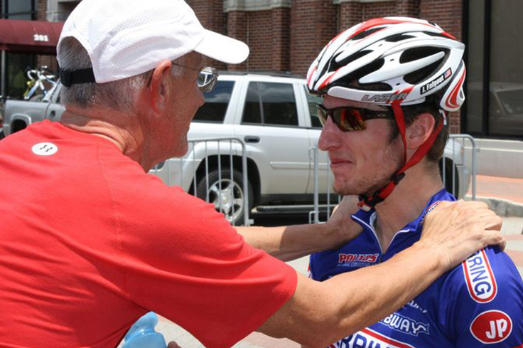 Coach supporting Athlete cyclist before Triathlon race