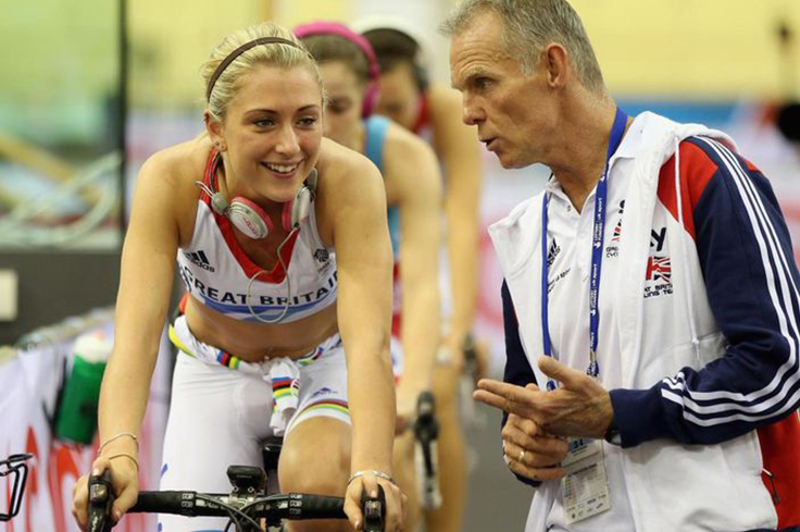 Cyclist coach giving verbal support to athlete cyclist