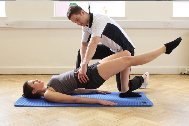 Physiotherapist instructing Physio Sessions with Athlete