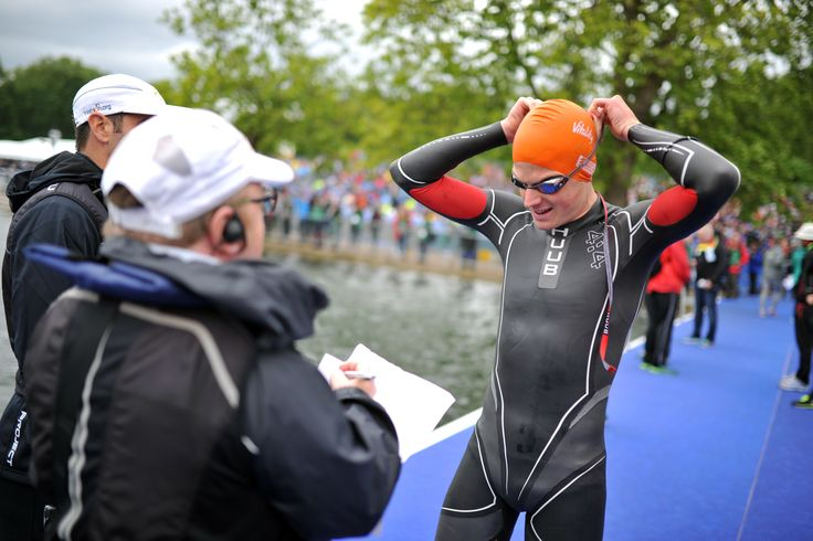 Swimmer receiving feedback from coach after triathlon race