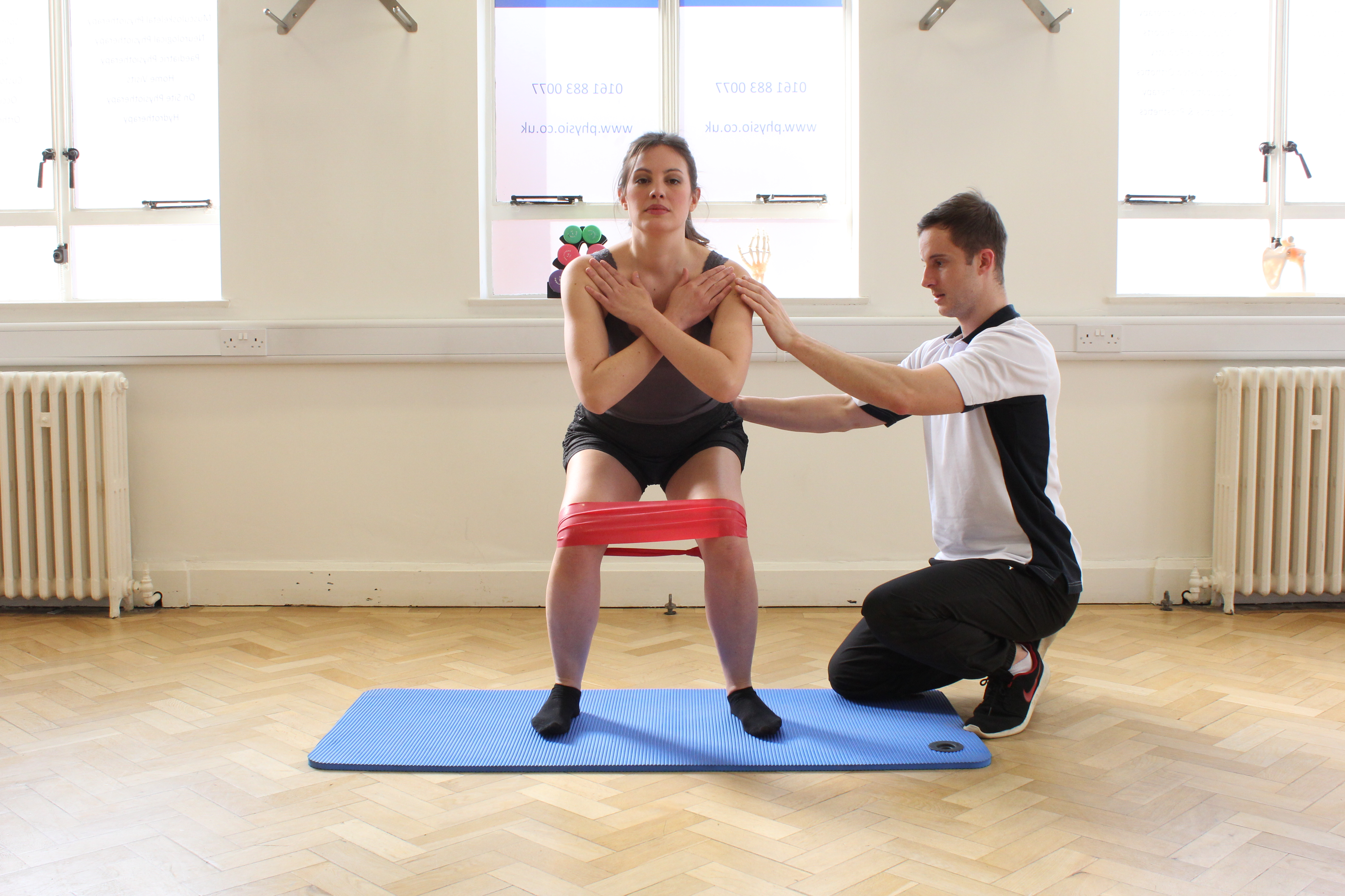 Richard Gregory Helping a client with Pilates