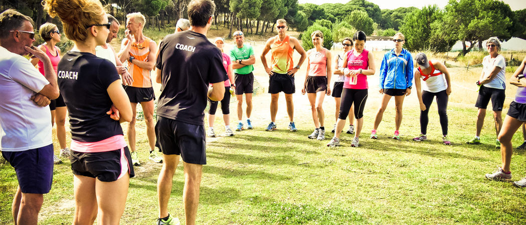Group of amateur runners get ready for training session.